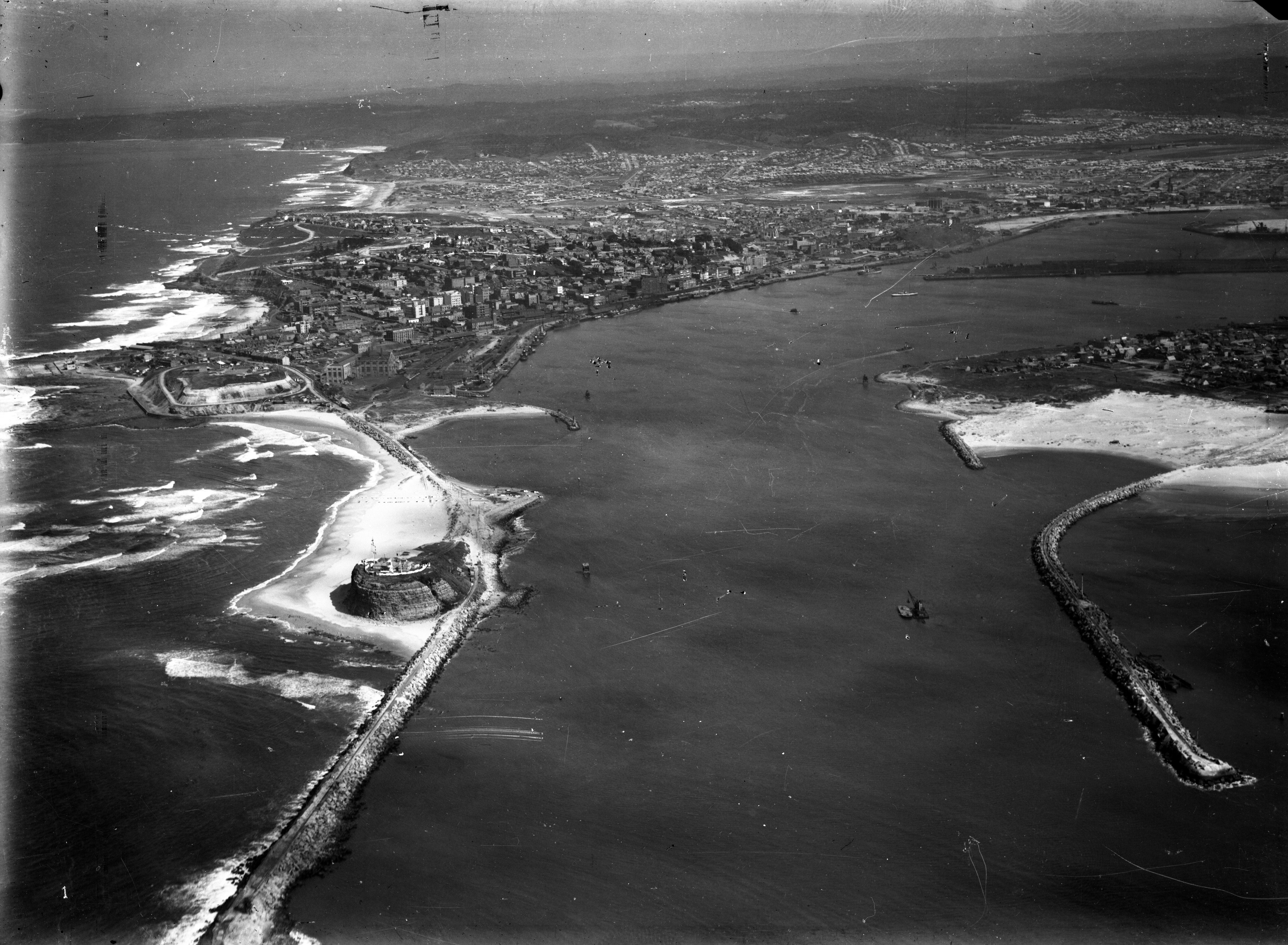 Newcastle Entrance, Knobbys head, Signal Hill, Fort Scratchley, Merewether, Port Hunter, Wave Trap, Pirate Point, Stockton, The Dyke. (Photograph by Milton Kent Airplane Photographs, Sydney. Southern No. 61.6.-.1.1934.jpg)