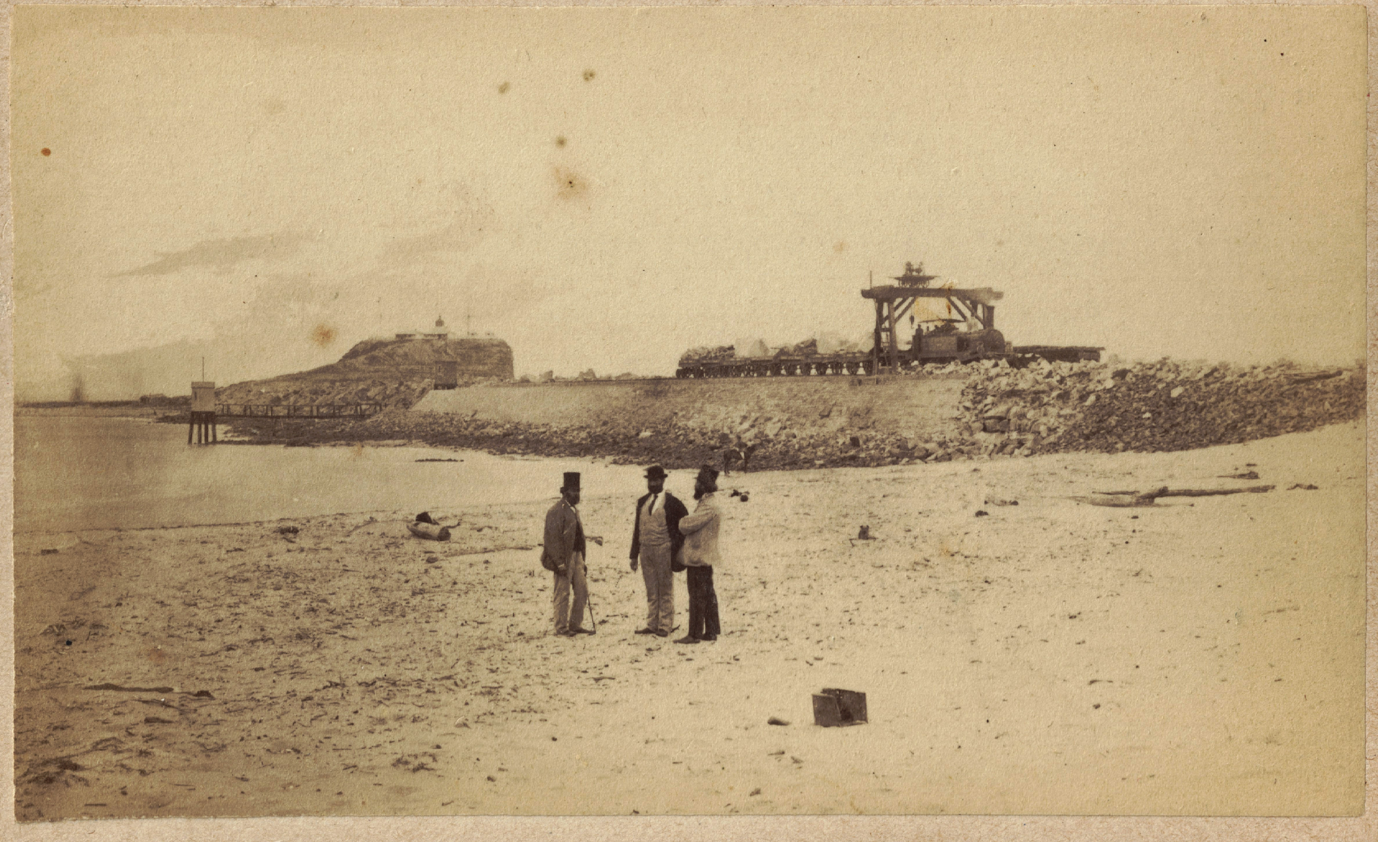 Newcastle Breakwater under construction, circa 22 October 1870 - 1 December 1870 (Photo Credit: Photographed by Beaufoy Merlin. Digitised by Anne Glennie from Glennie Family Albums) Click for larger view